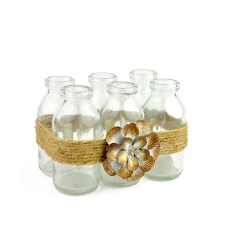 Set 6 botellas decoradas con flor 15 x 11 x 10 cm alto.